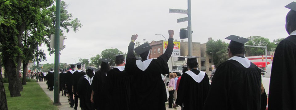Students celebrating their great accomplishment as they walk over to Holy Trinity Church for convocation.